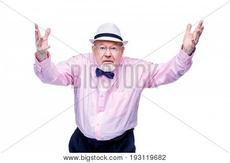 Angry old man expresses his dissatisfaction. Social protection, rights of pensioners. Isolated over white. Copy space.