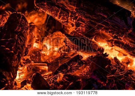 Smoldering and glowing coals after a fire at night