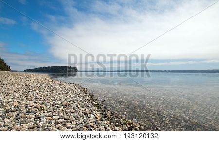 Shine Tidelands State Park shoreline of Bywater Bay near Port Ludlow in the Puget Sound in Washington State U S A