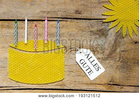 Beeswax, Cake With Candles And Sun On Wooden Table, German Words, All The Best
