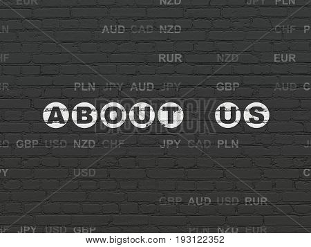 Business concept: Painted white text About us on Black Brick wall background with Currency