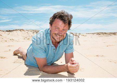 Happy Smiling Forty Years Old Caucasian Tourist Man Lying On Sand Beach Ocean