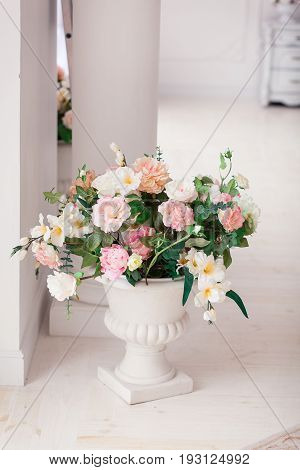 Rich bunch of pink peonies and lilac eustoma roses flowers. Fresh spring bouquet.