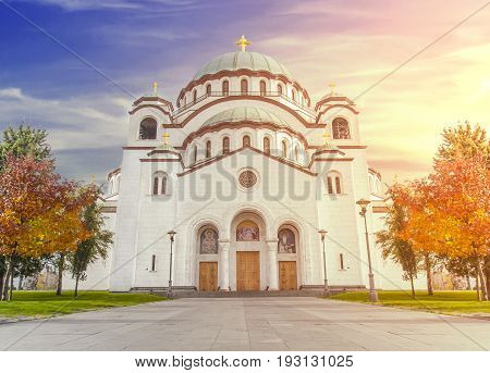 The Saint Sava christian catedral with blue cloudy burning sun sky in the capital Belgrade