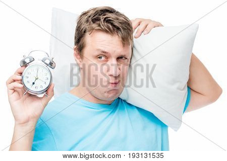 Unhappy Portrait Of A Man Sleepy With An Alarm Clock On A White Background