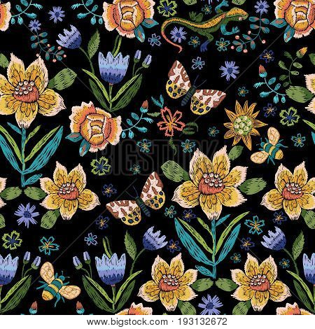 Embroidery ethnic simplified seamless pattern with butterflies and flowers. Vector embroidered floral design for fashion.