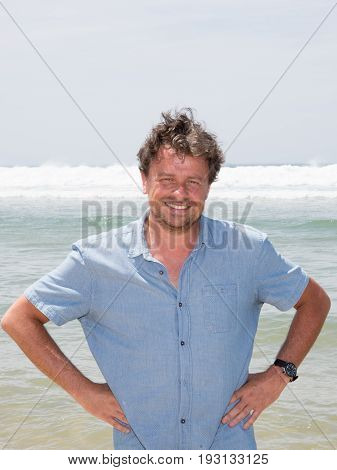 Color Portrait Photo Of A Happy Smiling Man In His Forties Looking Straight At Camera