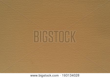 abstract grained texture of speckled fabric or paper material of dark beige color
