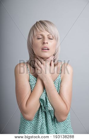 Sore throat woman on white background medical