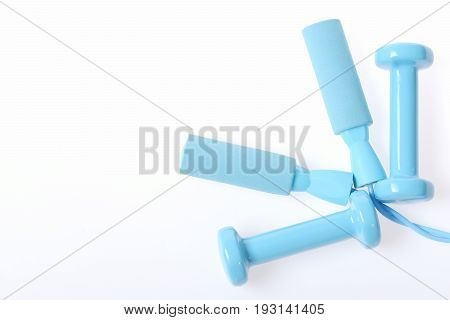 Composition Placed Neatly Holding Plastic Lightweight Dumbbells And Skipping Rope