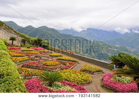 The beautiful colorful garden of Villa Rufolo under heavy autumn clouds high up on the slopes of the Amalfi Coast - Ravello Campania Italy