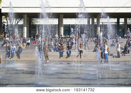 Moscow, Russia - May, 15, 2017: the group of fountains on an embankment of Moscow river near exhebition center on Krimsky bridge in Moscow, Russia
