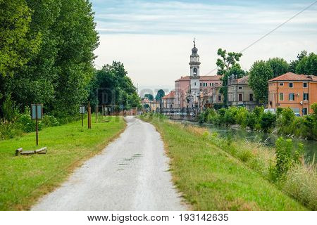 Battaglia Terme, Italy - June, 27, 2017: bank of a city channel in Battaglia Terme, Italy