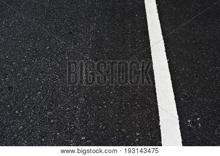 Close Up Asphalt Surface Of Road Divide White Lines