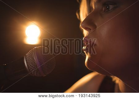 Close up of female singer performing in music concert