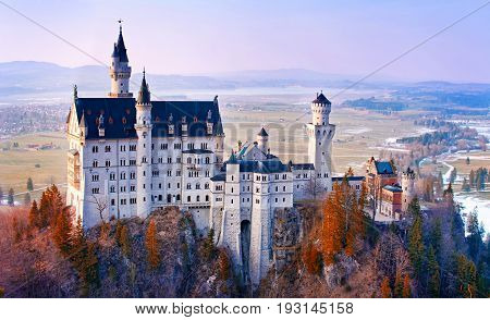 Neuschwanstein beautiful fairytale castle near Munich in Bavaria Germany with colorful trees. poster