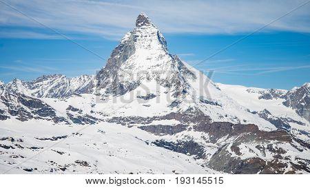 ZERMATT, SWITZERLAND - May 16. 2017: Matterhorn Mountain with white snow and blue sky in Zermatt city in Switzerland