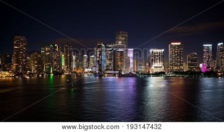 Miami skyscrapers at the night yacht or boat next to Miami downtown Aerial view south beach
