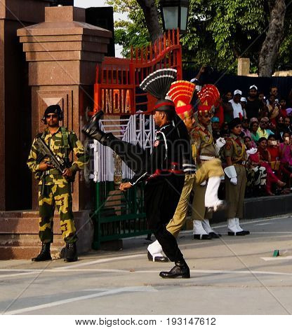 The marching Pakistani and Indian guards in national uniform at the ceremony of lowering the flags - 04-05-2015 border between Pakistan and India Wagah Lahore Pakistan