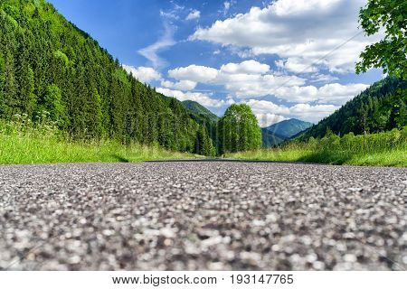 Empty asphalt road to nowhere. Forest at Lubochnianska valley in Slovakia