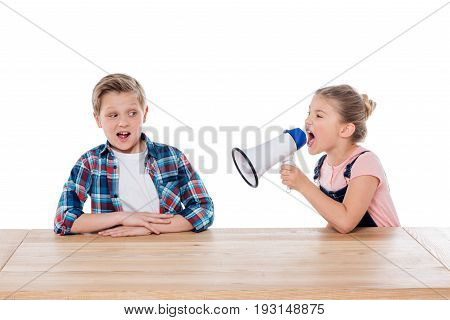 Angry Girl With Megaphone Yelling On Her Confused Brother Isolated On White