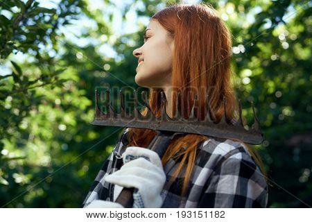 Woman working in the garden, gardener, summer.