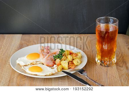 а plate of egg-plant with bacon on the table