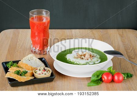 sweet-scented soup in a deep plate with cherry tomatoes
