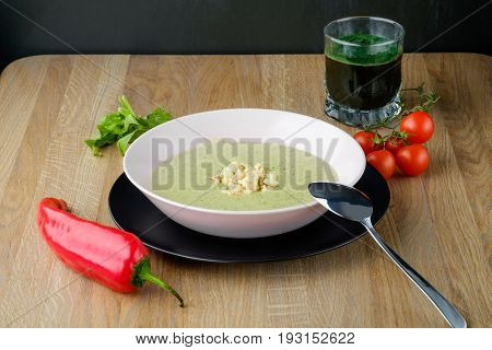 served plate of cream soup with juice