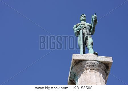Monument sculpture of the Belgrade Victor made of bronze, located in Kalemegdan park facing the Sava River and Zemun district, Belgrade, Serbia. poster