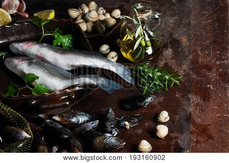 Fresh seabass mussel and cockles being prepared for a seafood dinner