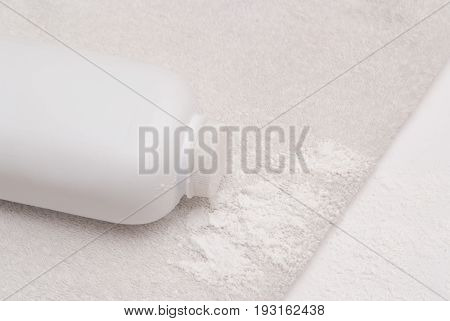 Talcum Powder On A Soft White Towel Background