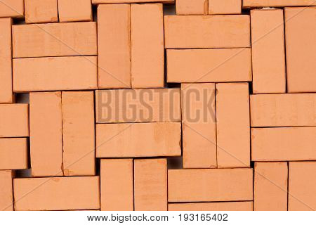 square profile with bricks as background pattern