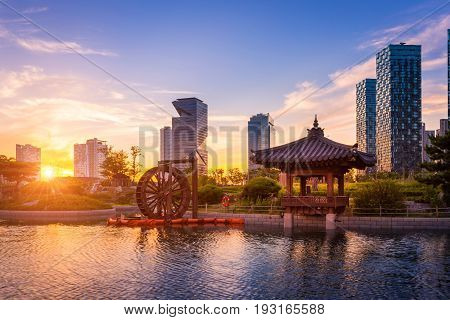 Seoul City With Beautiful Sunset, Traditional And Modern Architecture At Central Park In Songdo Inte