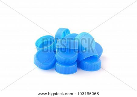 pile of blue plastic bottle cap isolated on white background