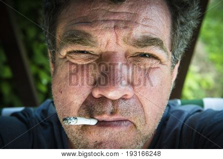 Smoker middle-aged man close-up portrait