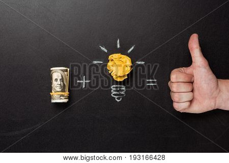 Business Concept Made Of Light Bulb Symbol, Money And Thumb Up Sign On Blackboard
