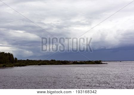 Gulf coast the channel empties into the Bay the sky with clouds water