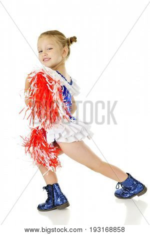 An adorable preschooler, dressed in her patriot outfit, shaking and carrying red and white pom poms, as she takes giant steps in her sparkly boots.  Motion blur on pom poms. On a white background.