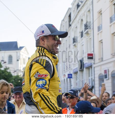 LE MANS, FRANCE - JUNE 16, 2017: Rubens Barrichello brazilian pilot racer with his team Dallara P217 Gibson 29 on a parade of pilots racing at Le mans, France