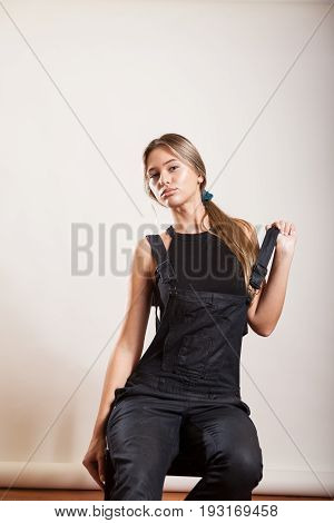 Beautiful sexy woman with suspenders on white background in studio photo