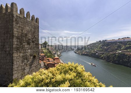 Porto landscape view over Douro River and tradicional Rabelo boat on a summer day Portugal. on a summer day Portugal.