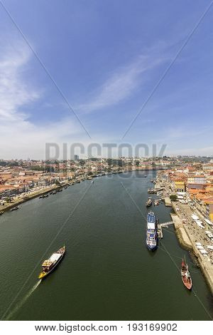 Porto landscape view over Douro River and tradicional Rabelo boats on a summer day Portugal. on a summer day Portugal.