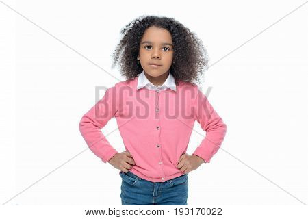 Little African American Girl Posing In Pink Cardigan Isolated On White