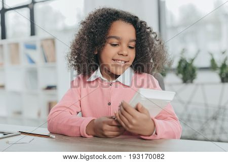 Little Happy African American Girl Pretending To Be Businesswoman And Working With Calculator In Off