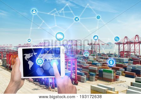 Hand holding tablet is pressing button Logistics connection technology interface global partner connection for logistic import export background. Business logistics concept internet of things