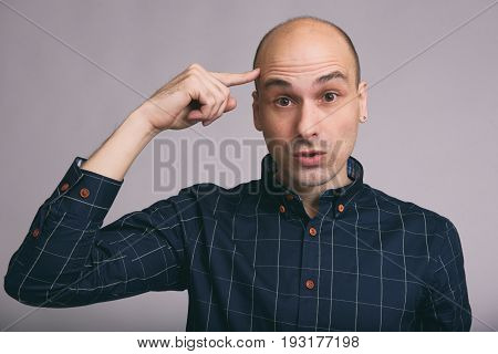 Bald Man Thinking With Finger On Head