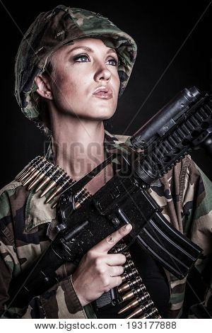 Beautiful female military soldier with gun