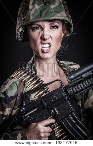 Woman soldier with military machine gun