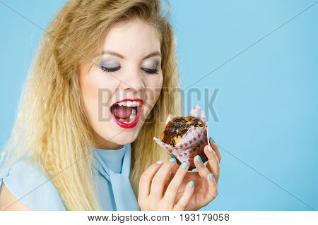 Attractive Woman Holds Cake In Hand